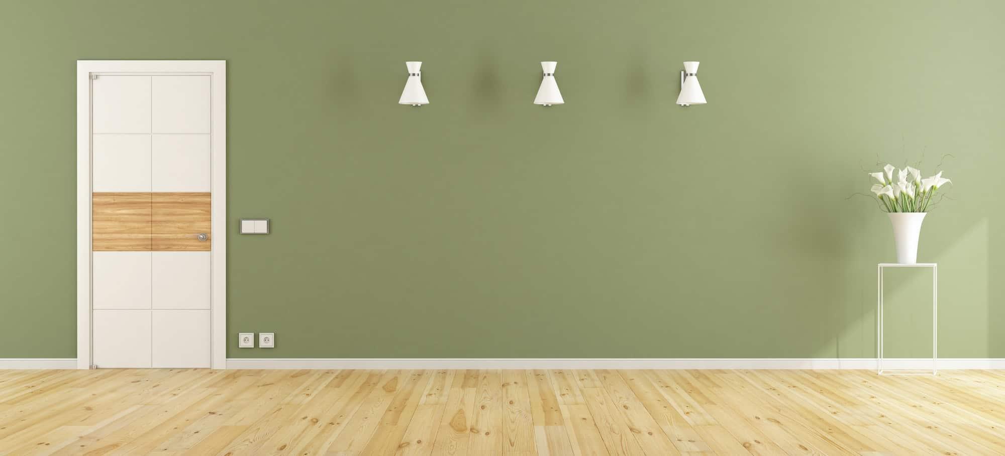 Empty green room with closed door